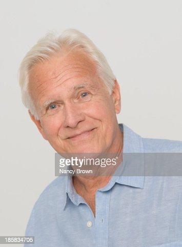 Caucasian Senior Man Head Shot At Camera. : Foto de stock