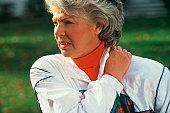 caucasian senior woman with shoulder pain