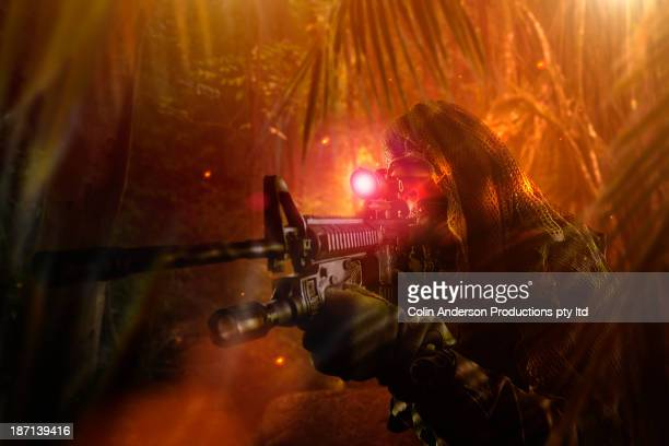 Caucasian soldier searching with gun