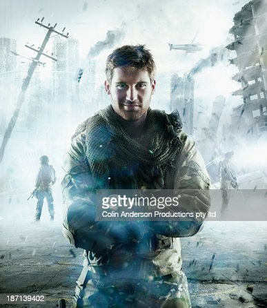 Caucasian soldier standing in combat zone