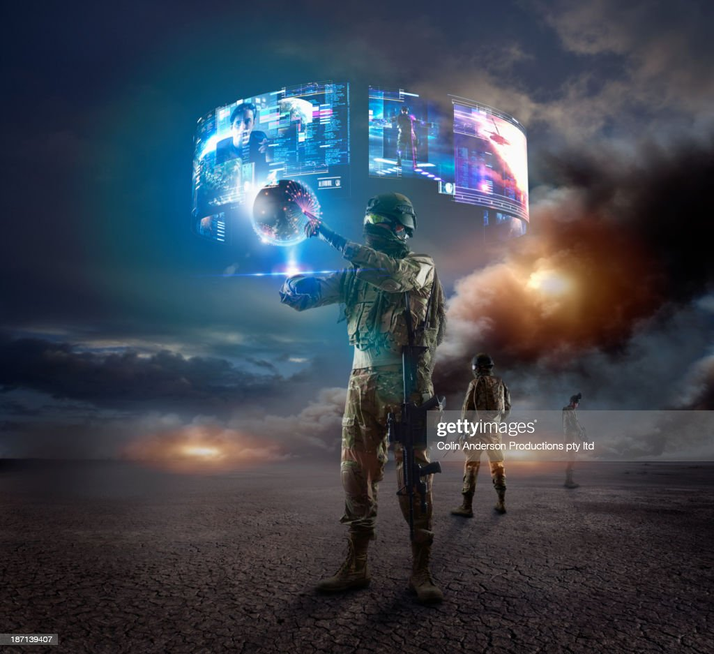 Caucasian soldier using holographs in combat zone : Stock Photo