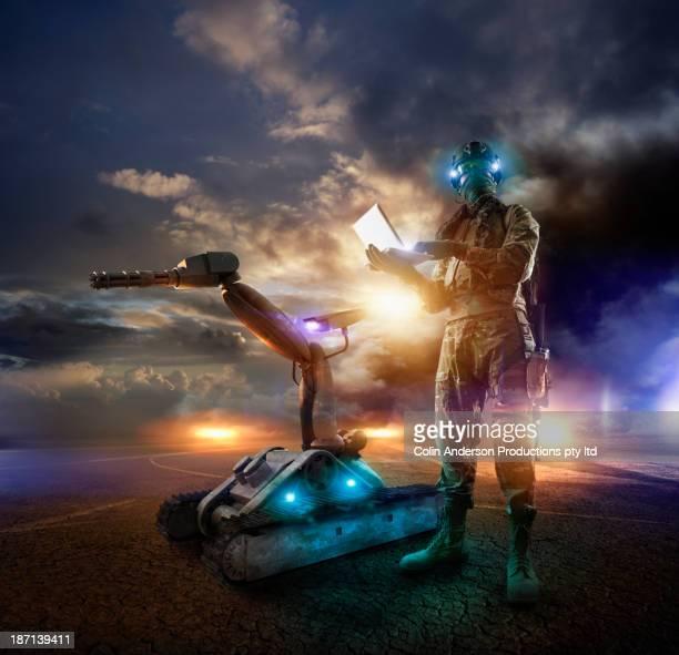 Caucasian soldier using laptop in combat zone