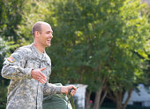 Caucasian soldier walking outdoors