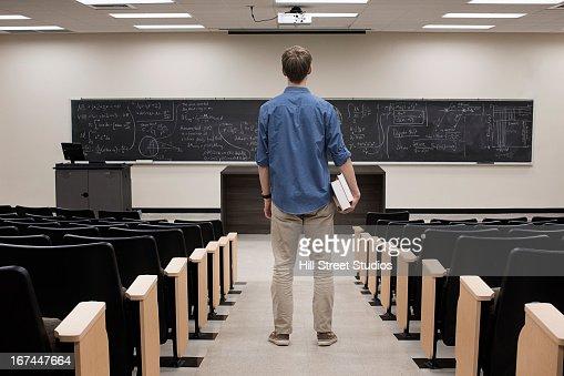 Caucasian student standing in classroom