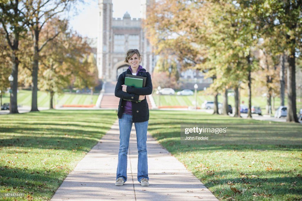 Caucasian student standing on campus : Stock Photo