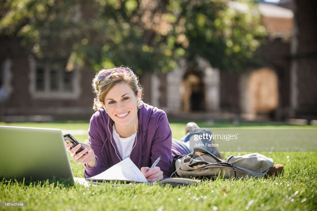 Caucasian student studying on campus : Stock Photo