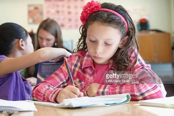 Caucasian student working in class