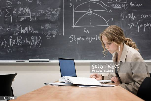 Caucasian student working in classroom