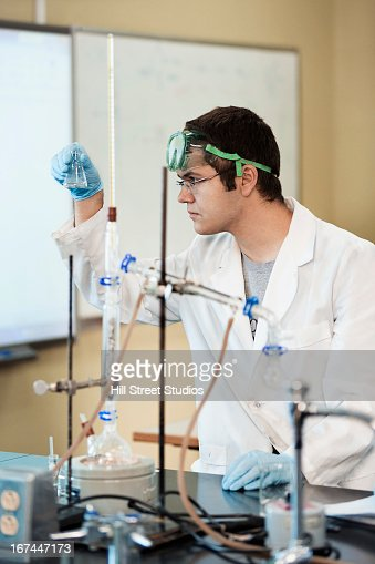 Caucasian student working in lab classroom : Stock Photo