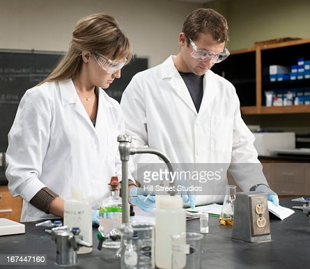 Caucasian students working in lab classroom : Stock Photo