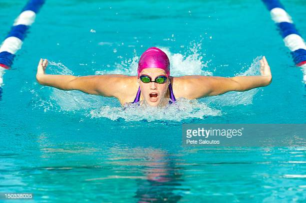 Caucasian swimmer in swimming lane