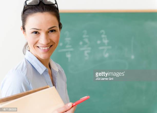 Caucasian teacher smiling in classroom