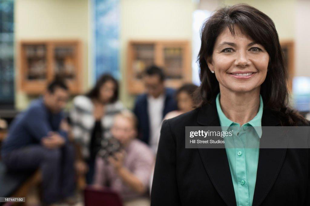 Caucasian teacher smiling in lab classroom : Stock Photo