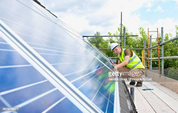 Caucasian technician working on solar panels