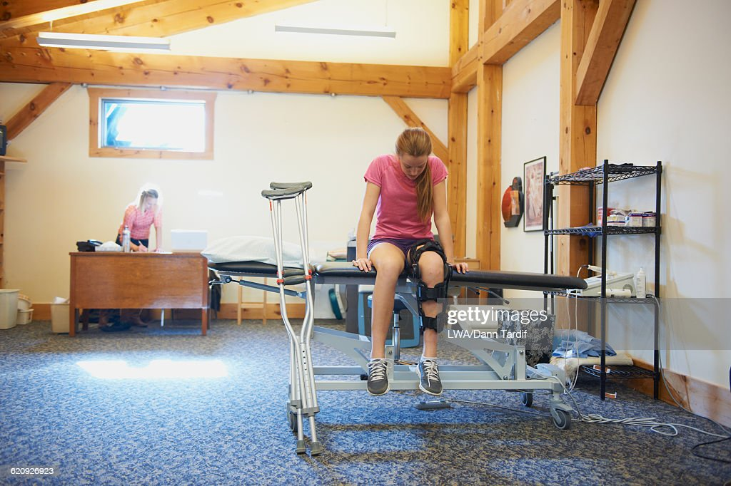 Caucasian teenage girl having physical therapy