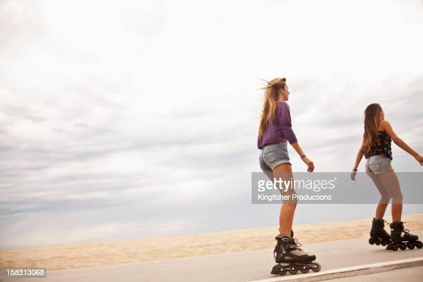 Caucasian teenage girls roller blading