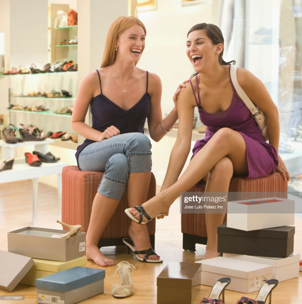 Caucasian teenage girls shoe shopping