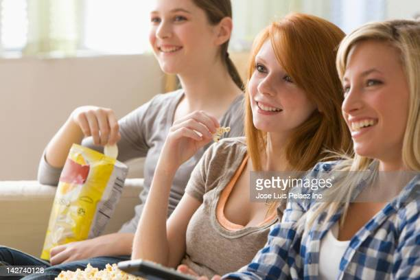 Caucasian teenage girls watching television