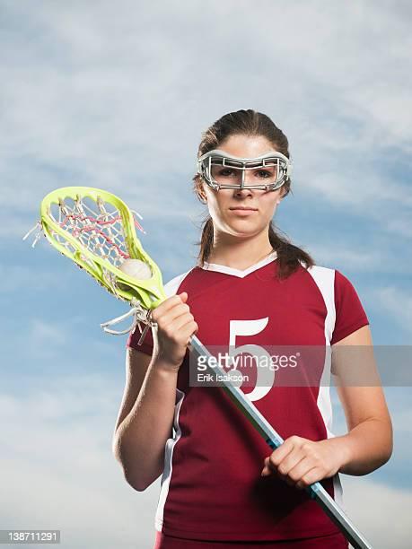 Caucasian teenage lacrosse player