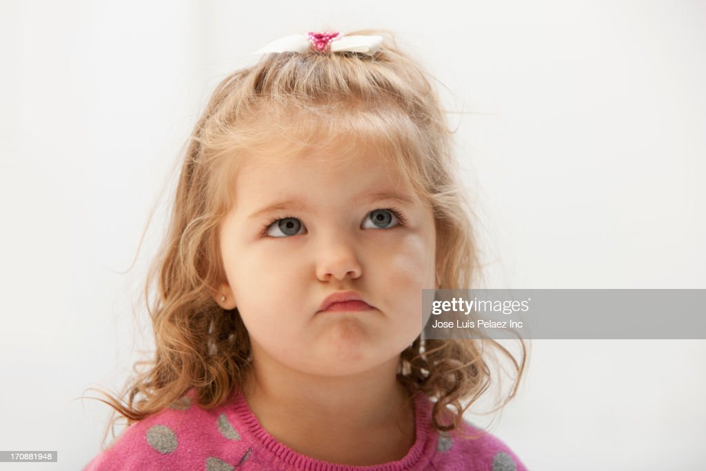 Caucasian toddler pouting