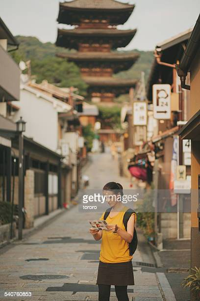 Caucasian tourist looking at map in Kyoto