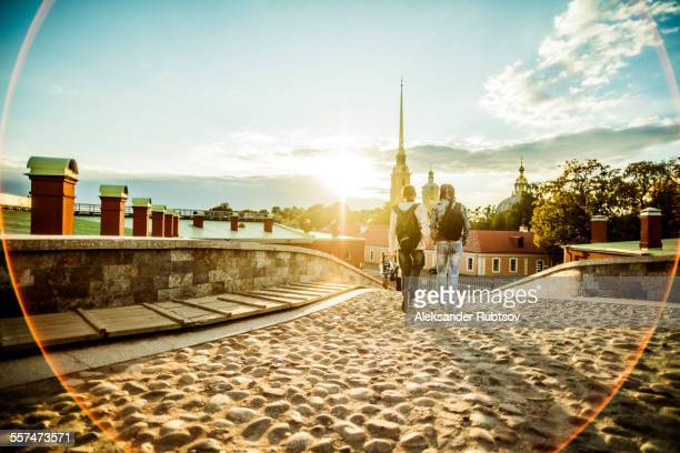 Caucasian tourists walking on cobblestone Leningrad street, Leningrad, Russia
