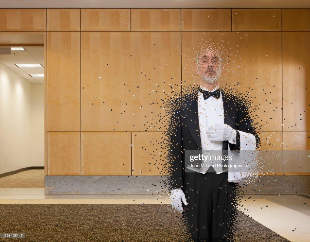 Caucasian waiter dissolving in office