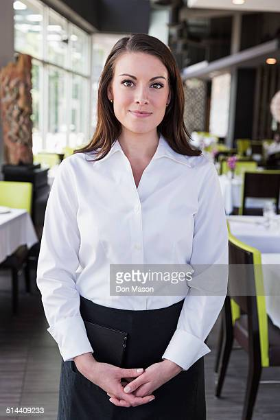 Caucasian waitress smiling in restaurant