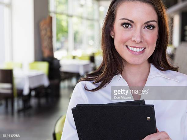 Caucasian waitress smiling in restaurant