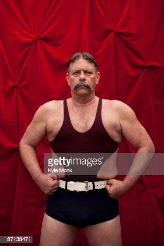 Caucasian weight lifter flexing his muscles