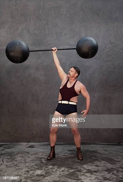 Caucasian weight lifter holding weights