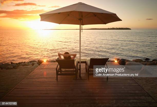 Caucasian woman admiring sunset over water, Denarau Island West, Nadi, Fiji