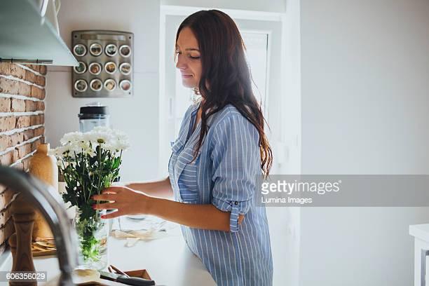 Caucasian woman arranging flowers