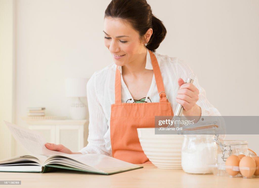 Caucasian woman baking in kitchen