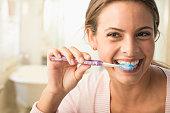 Caucasian woman brushing her teeth