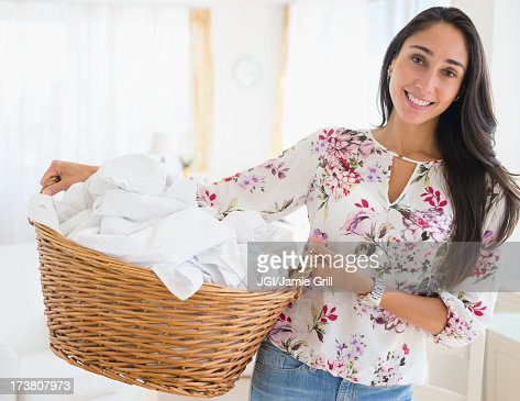 Caucasian woman carrying basket of laundry