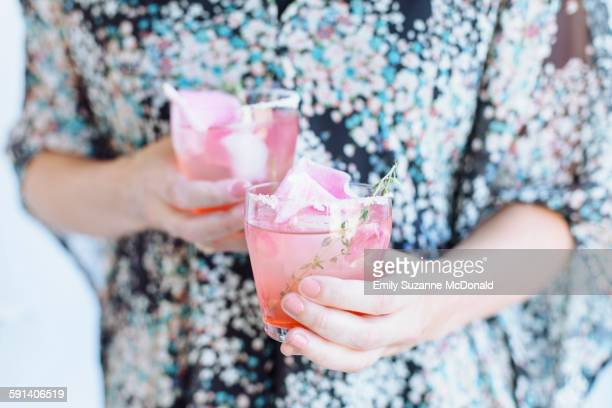 Caucasian woman carrying cocktails