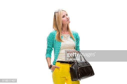 Caucasian woman carrying purse
