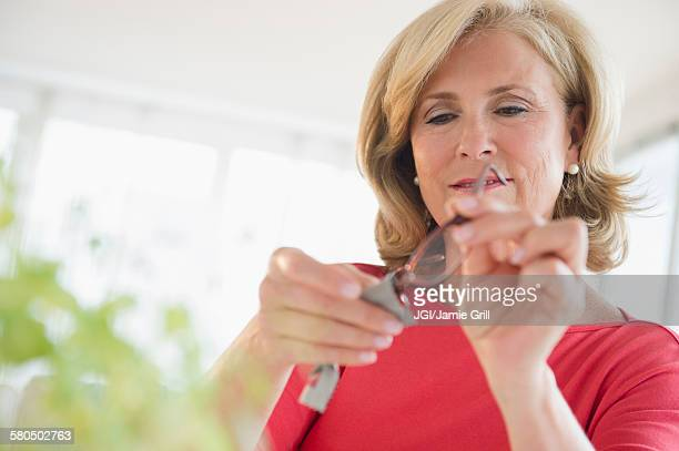 Caucasian woman cleaning eyeglasses