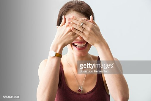 Caucasian woman covering her eyes