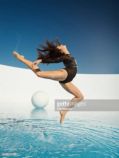 Caucasian woman dancing on water surface