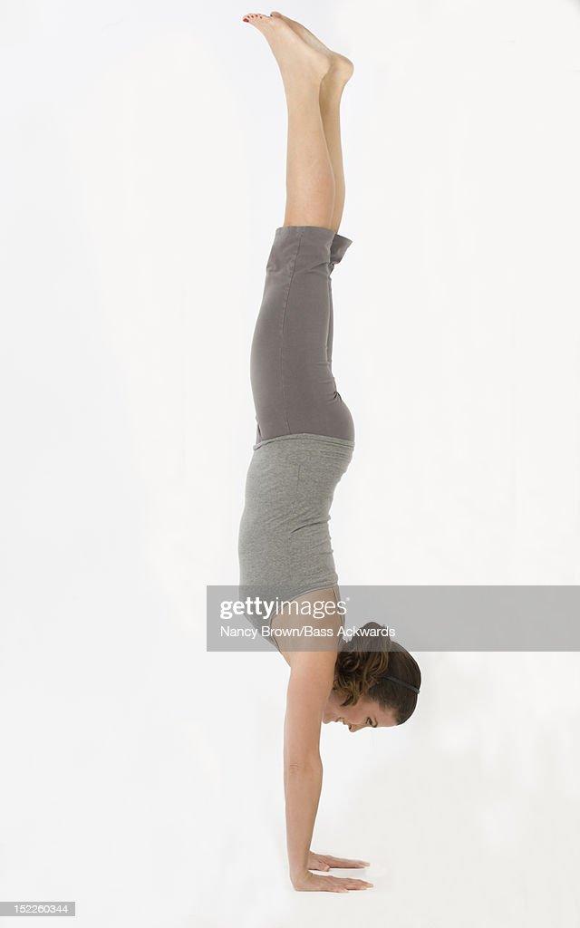 Caucasian woman doing Power Yoga. : Stock Photo