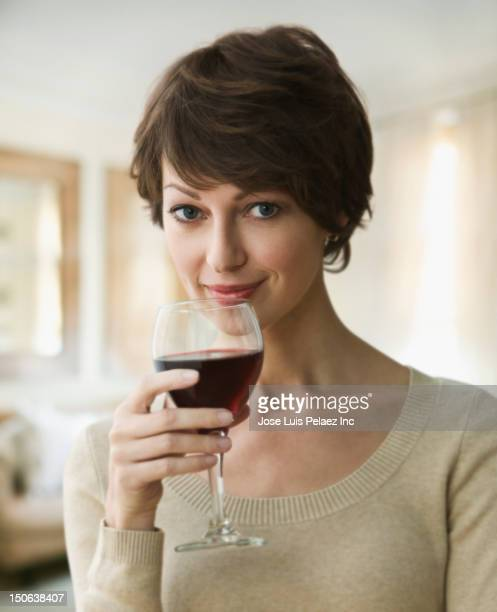 Caucasian woman drinking red wine