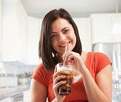 Caucasian woman drinking soda