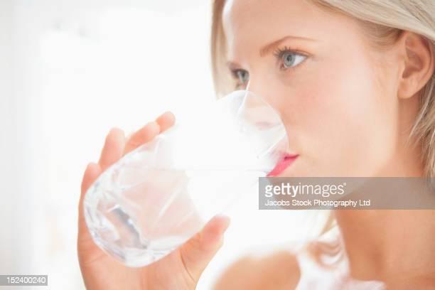 Caucasian woman drinking water