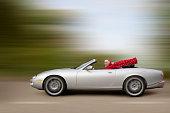 Caucasian woman driving car at high speed