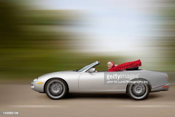 Caucasian woman driving car at high speed