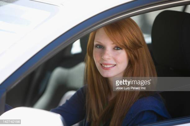 Caucasian woman driving car