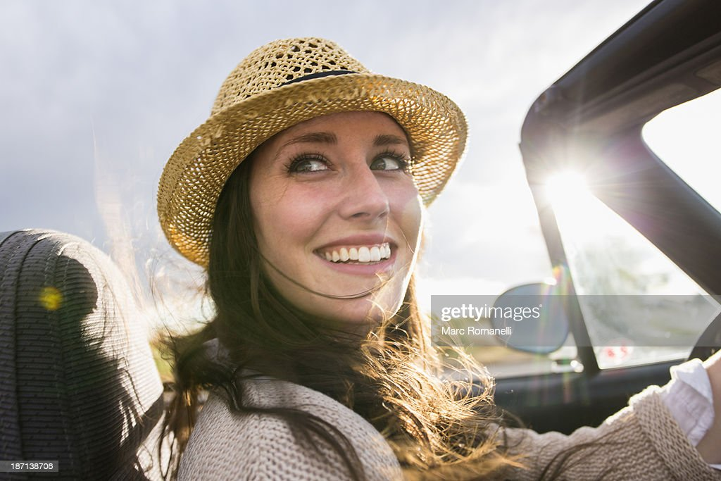Caucasian woman driving convertible : Stock Photo