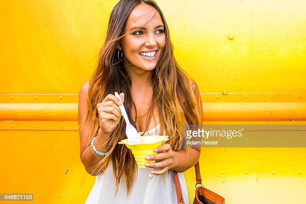Caucasian woman eating shaved ice